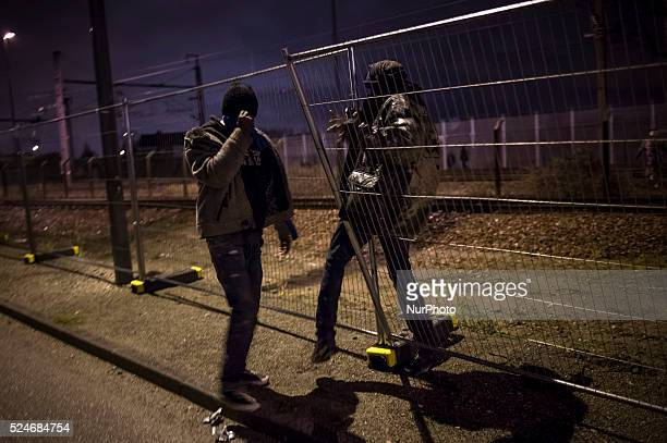 Refugees try how each night to cross the border to get to England via the railway line from the northern French city of Calais on November 7 2015...