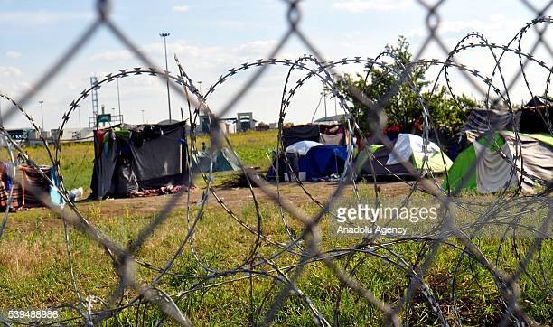 Refugees try to live under hard conditions in a tent camp as Hungary closes its Serbia and Croatia borders with razor wire fence near Csongrad...