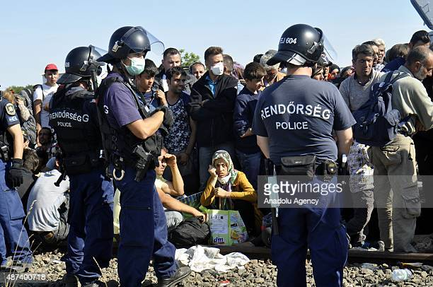 Refugees wait at the control and registration tent camp in Roszke on September 9 2015 in Budapest Hungary Refugees are planning to enter Austria...