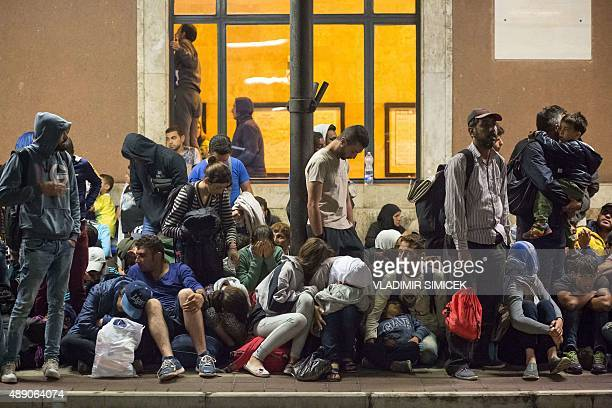 Refugees wait for a train from Gyor to Hegyeshalom in Hungary on September 19 2015 During the night they were transported from the Croatian border in...