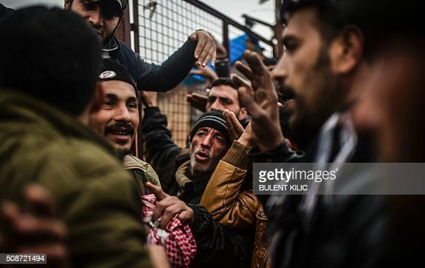 TOPSHOT Refugees wait for tents as Syrians fleeing the northern embattled city of Aleppo wait on February 6 2016 in Bab alSalama near the city of...