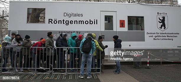 Refugees wait in front of the State Office for Health and Social Affairs during freezing temperatures in Berlin Germany on January 5 2015