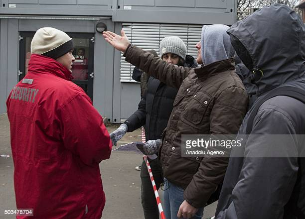 Refugees wait in front of the State Office for Health and Social Affairs during freezing temperatures in Berlin, Germany on January 5, 2015.