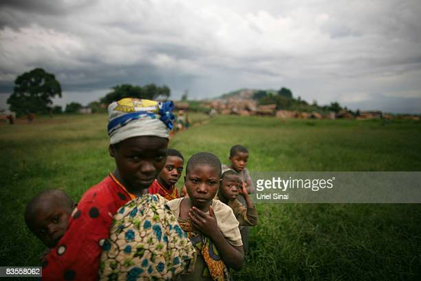 Refugees wait near their shelters in the village of Tongo in the hills outside Goma on November 4 2008 in North Kivu provinceDemocratic Republic of...