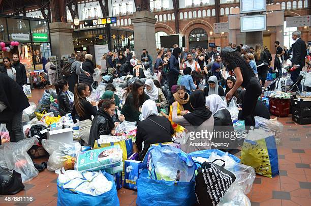 Refugees wait to board a train to Malmoe Sweden at Copenhagen train station on September 10 2015 in Denmark