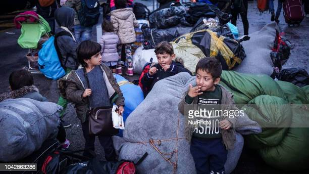 Refugees wait to board on a coach bus at the Port of Pireaus 29 September 2018 Thousand migrants and refugees are scheduled to arrive at the Piraeus...