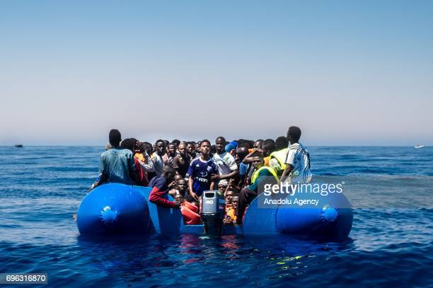 Refugees wait to get on onboard the rescue vessel Golfo Azzurro by members of the Spanish NGO Proactiva Open Arms after being rescued from a wooden...