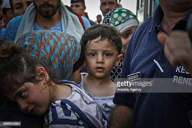 Refugees wait to get on the buses those will bring them to the Croatian village Baranysko Petrovo near Hungarian border in Beli Manastir in Croatia...