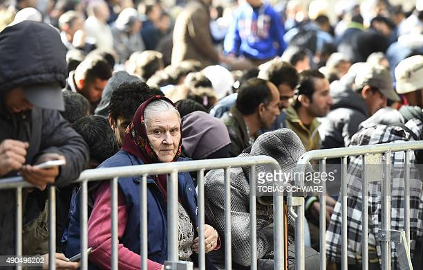 Refugees wait to register outside the State Office of Health and Social Affairs in Berlin where hundreds of migrants wait to receive help from the...