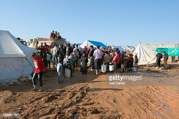 syrian refugees in internally displaced persons camp at atmeh - humanitarian aid stock pictures, royalty-free photos & images