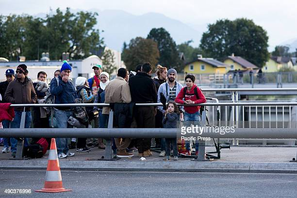 FREILASSING BAVARIA GERMANY Refugees waiting in line on one of the main bridges from Austria to Germany blocked by security forces Thousands of...