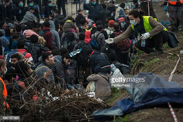Refugees waiting to cross the SerbianCroatian border at the refugee camp of Bapska Millions of refugees flee from their countries to seek asylum from...