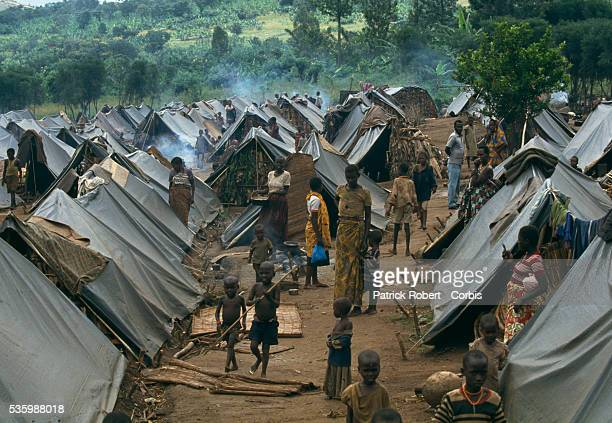 Refugees walk among the tents in a refugee camp for Tutsis near Kirundo in northern Burundi. The camp was created for refugees entering the country...