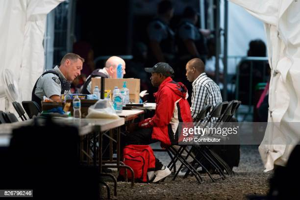 Refugees who crossed the Canada/US border illegally near Hemmingford Quebec are processed in a tent after being arrested by the Royal Canadian...