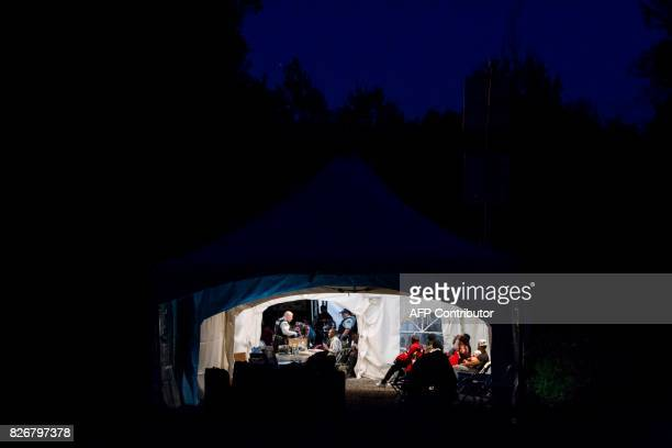 Refugees who crossed the Canada/US border illegally near Hemmingford Quebec are processed in a tent after being arrested by the RCMP on August 5 2017...