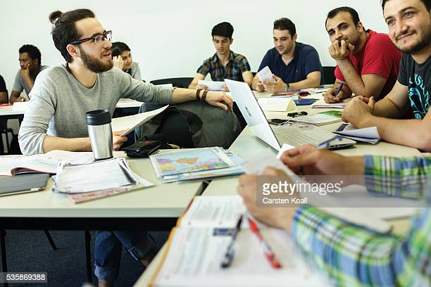 Refugees who have received asylum status in Germany attend a class to help them prepare for a study program at the Freie Universitaet Berlin or Free...