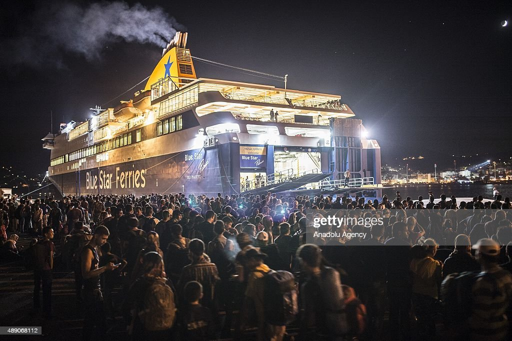 Refugees who took a boat from Turkey to Lesbos Island wait at a port to get a ferryboat to go to Athens on September 19, 2015. Refugees who begin a journey with a hope to have high living standards away from conflicts, continue using Greece's Lesbos island as a transit point on their way to Europe.