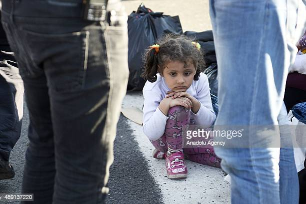 Refugees who want to go to Europe wait in front of the police barricade on TEM highway in Edirne Turkey on September 19 2015 Turkish security forces...