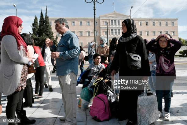 Refugees who were on hunger strike for 14 days to demand a faster family reunification process in Germany prepare to leave the Syntagma square in...