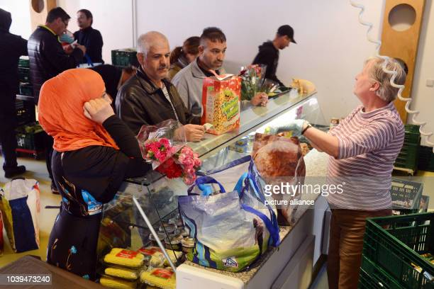 Refugees with food stamps receive food items from a distribution facility of the local food bank in Leipzig Germany 01 October 2015 The up to 200...