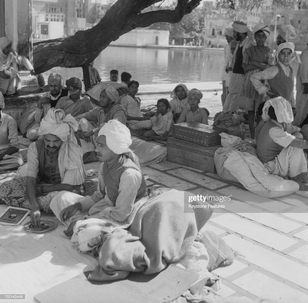 Refugees with their remaining belongings at the Golden Temple the holiest shrine of Sikhism in Amritsar Punjab after communal riots during the...