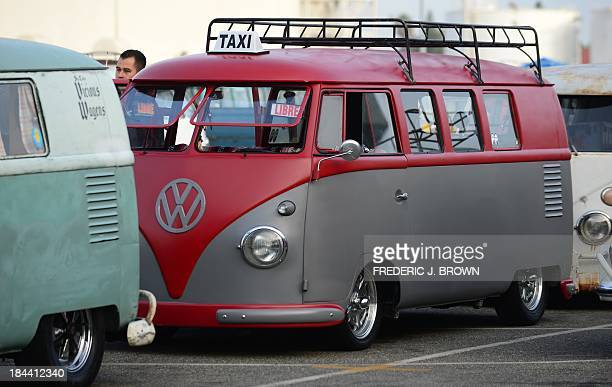 A refurbished 1956 Volkswagen bus with Taxi sign from Mexico is displayed at 'Das OCTO Fest 2013' a swap and display gathering for enthusiasts and...