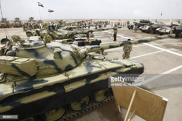 Refurbished Russian made T72 tanks are on display during training operations at a desert range some 40 kms south of the town of Latifiyah on May 11...