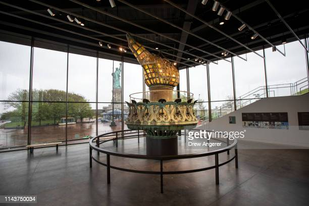 A refurbished version of the original Statue of Liberty torch is on display during a tour of the new Statue of Liberty Museum May 13 2019 on Liberty...