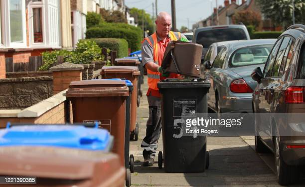 Refuse collector empties bins on April 27, 2020 in Northampton, England. British Prime Minister Boris Johnson, who returned to Downing Street this...