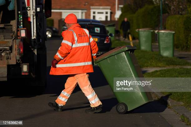 Refuse collector from Redcar and Cleveland Council works to empty bins in the streets of Saltburn as the UK adjusts to life under the Coronavirus...