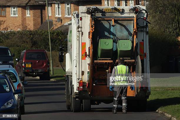 Refuse collectors empty green 'wheelie' bins on March 2 2010 near Leatherhead England As the UK gears up for one of the most hotly contested general...