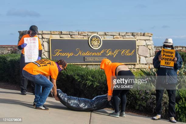 RefuseFascism supporters deliver symbolic homemade bodybags in front of the Trump National Golf Club during an antiTrump protest on April 18 in...