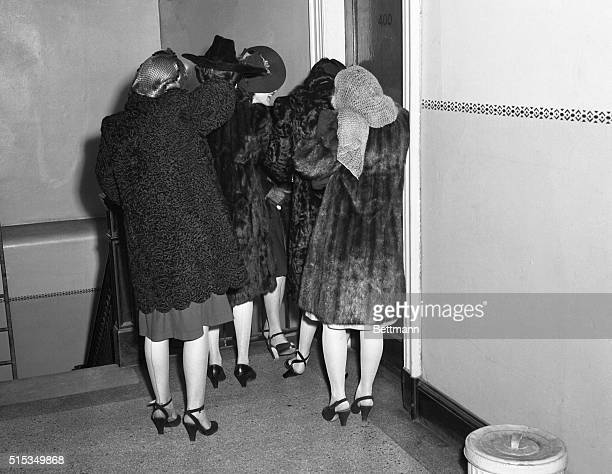 Refusing to show their faces to the camera these girls wait to appear before US Commissioner Needham C Trunage in Washington They were part of a...