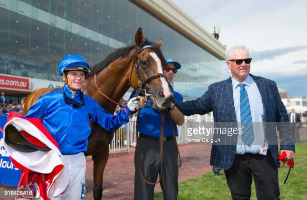 Reg Fleming and Craig Williams pose with Hartnell after winning Race 8 Ladbrokes CF Orr Stakes during Melbourne Racing at Caulfield Racecourse on...