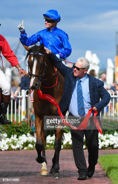 Reg Fleming leads in Craig Williams riding Hartnell after winning Race 8 Ladbrokes CF Orr Stakes during Melbourne Racing at Caulfield Racecourse on...