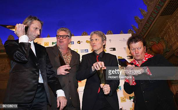 Reg Mombassa Greedy Smith Peter O'Doherty and Martin Plaza of the band Mental as Anything pose with their Hall of Fame award bakstage at the 2009...
