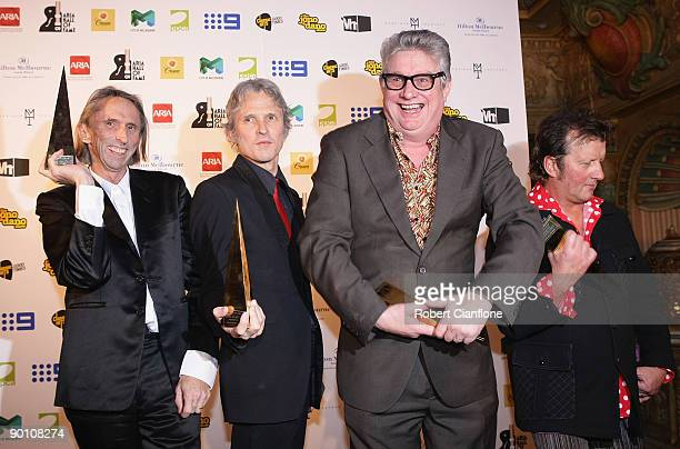 Reg Mombassa Peter O'Doherty Greedy Smith and Martin Plaza of the band Mental as Anything pose with their Hall of Fame award bakstage at the 2009...