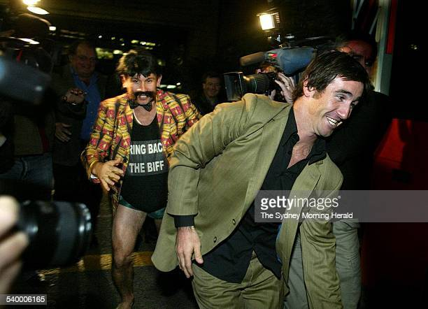 Reg Reagan rushes Andrew Johns past the media during the launch of his new DVD at CUB breweries on Broadway 22 June 2004 SMH Picture by CRAIG GOLDING