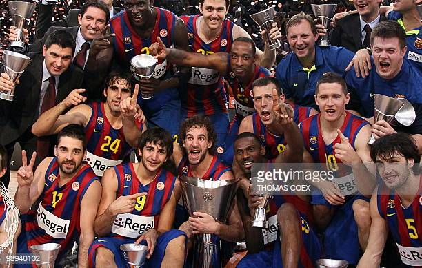 Regal Barcelona's players celebrate with their trophies after winning the Euroleague basketball final match against Olympiacos in ParisBercy...