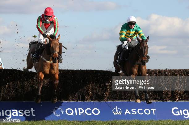 Regal Encore and Richie Mclernon lead Minella Daddy and Sean Bowen over the last fence before going on to win The Keltbray Swinley Chase run during...