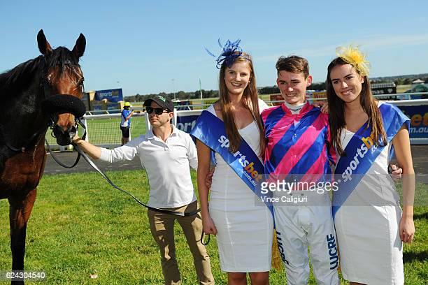 Regan Bayliss poses with sportsbet models after riding Pilote D'Essai to win Race 8 Sportsbetcomau Ballarat Cup at Ballarat Racecourse on November 19...