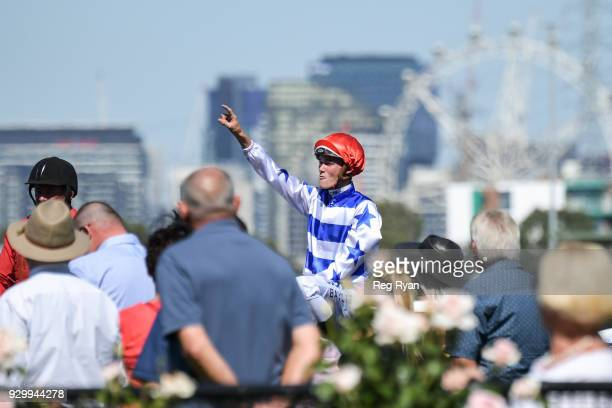 Regan Bayliss returns to the mounting yard aboard Redkirk Warrior after winning the Lexus Newmarket Handicap at Flemington Racecourse on March 10...
