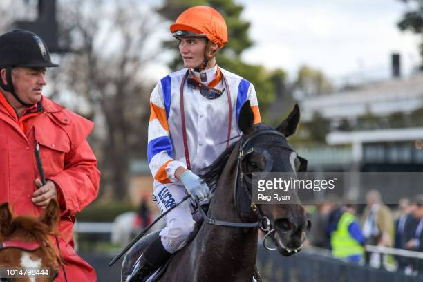Regan Bayliss returns to the mounting yard on Crockett after winning the VRC Member Abigail Bartlett Handicap at Flemington Racecourse on August 11...