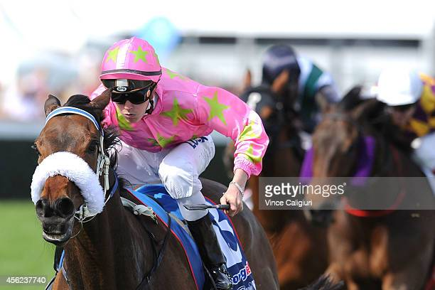 Regan Bayliss riding Kenjorwood winning Race 4 during Melbourne Racing at Caulfield Racecourse on September 28 2014 in Melbourne Australia