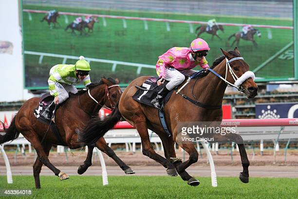 Regan Bayliss riding Kenjorwood wins Race 2 the Betty Moran Gregory Nugent Handicap during Melbourne Racing at Flemington Racecourse on August 9 2014...