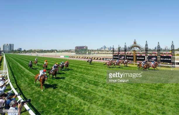 Regan Bayliss riding Redkirk Warrior defeats Craig Williams riding Brave Smash in Race 6 Lexus Newmarket Handicap during Melbourne Racing at...