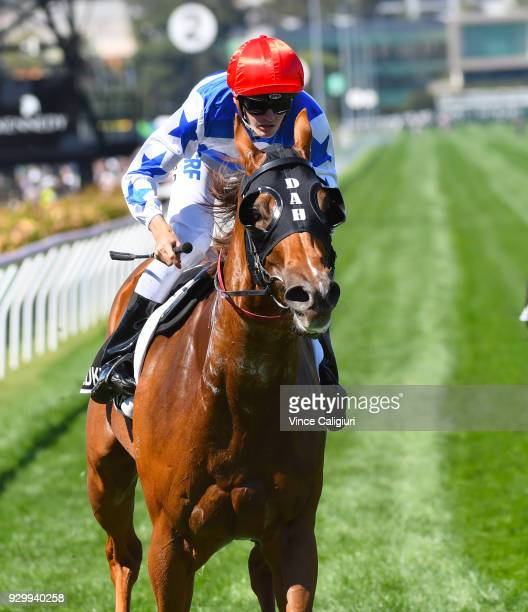 Regan Bayliss riding Redkirk Warrior wins Race 6, Lexus Newmarket Handicap during Melbourne Racing at Flemington Racecourse on March 10, 2018 in...