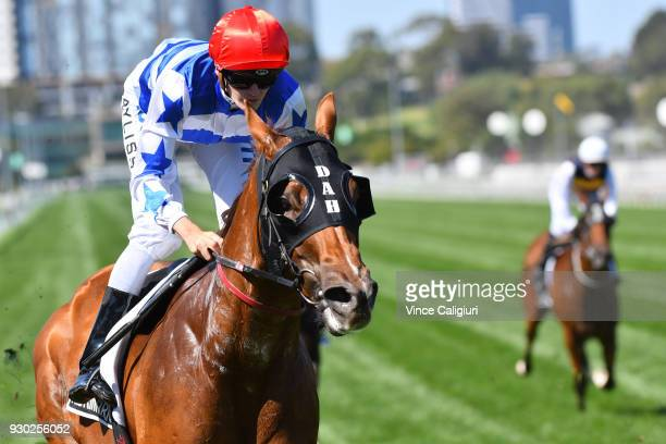 Regan Bayliss riding Redkirk Warrior wins Race 6 Lexus Newmarket Handicap during Melbourne Racing at Flemington Racecourse on March 10 2018 in...