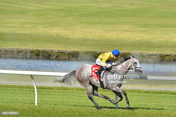 Regan Bayliss riding Top Me Up wins race 8 during Ladbrokes Park Race Day at Sandown Racecourse on December 24 2016 in Melbourne Australia