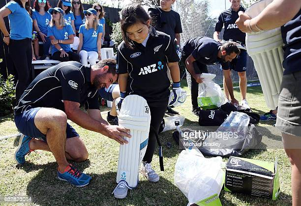 Regan BrabantHebry gets geared up with the help of Black Cap Colin de Grandhomme after she and her brother cricket fan Christopher BrabantHenry aged...